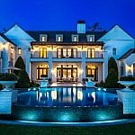 Orlando Pool Photography showing this beautiful mansion at dusk