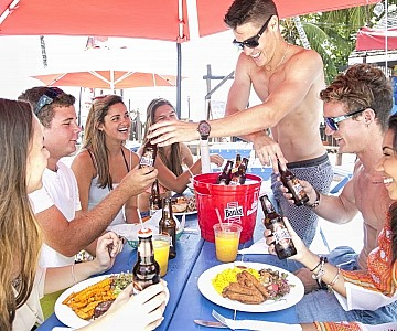 A group of young friends enjoy a fun lunch at Harbour Lights Beach Day